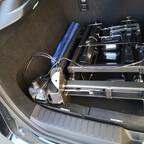 Zusammengeklappt im Kofferraum